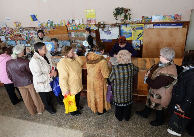 Ukraine's parliament adopted on Monday a law restricting the payment of pensions to working pensioners until 2016, a press release on Ukraine's Verkhovna Rada website said