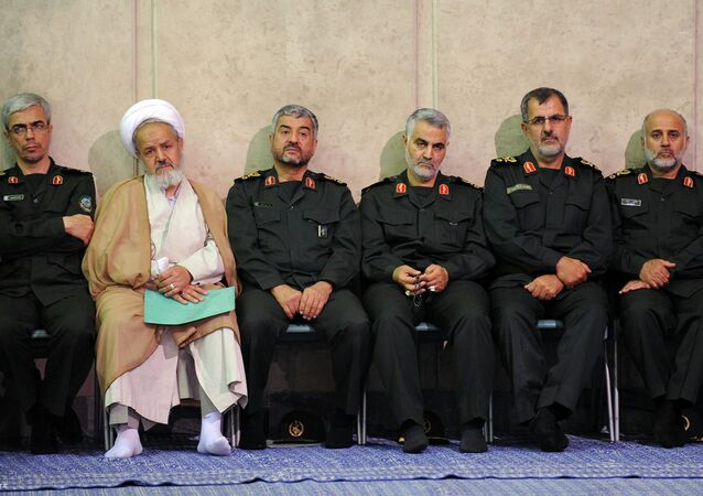 Gen. Qasem Soleimani, third right, sits next to the commander of the Revolutionary Guard, Mohammad Ali Jafari, third left, in a meeting of the commanders of the Revolutionary Guard with Supreme Leader Ayatollah Ali Khamenei in Tehran, Iran.