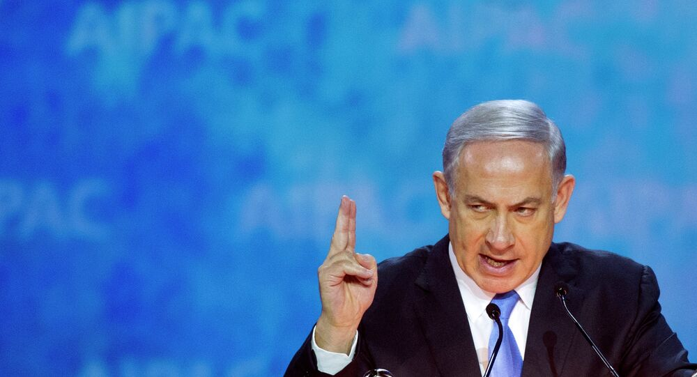 Israeli Prime Minister Benjamin Netanyahu gestures while addressing the 2015 American Israel Public Affairs Committee (AIPAC) Policy Conference in Washington