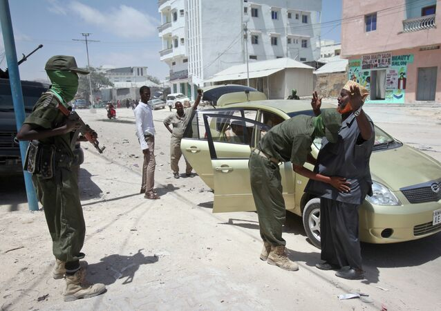 A man is questioned and searched during random vehicle check as part of an operation by Somali security forces against suspected members of the militant group al-Shabab in the capital Mogadishu, Somalia. File photo