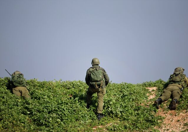 Israeli soldiers take up a position near the Israel-Lebanon Border, northern Israel. File photo