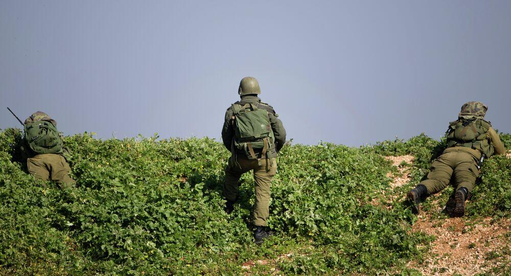Israeli soldiers take position near the Israel-Lebanon Border, northern Israel
