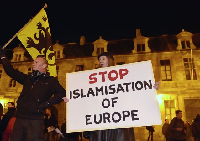 Members of the Belgian branch of Germany's anti-Islam group, PEGIDA (Patriotic Europeans Against the Islamisation of the West), take part in a demonstration in Antwerp