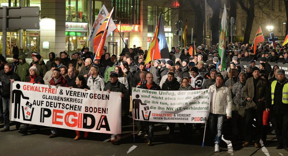 People march during a demonstration of the socalled movement of Patriotic Europeans Against the Islamisation of the Occident aka Pegida, in Dresden