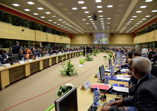 EU commissioners, leaders of Ebola-hit countries in west Africa and Queen Mathilde of Belgium (On screen) attend a conference on Ebola on March 3, 2015 in Brussels