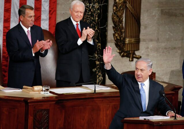 Israeli Prime Minister Benjamin Netanyahu waves as he steps to the podium prior to speaking before a joint meeting of Congress on Capitol Hill.