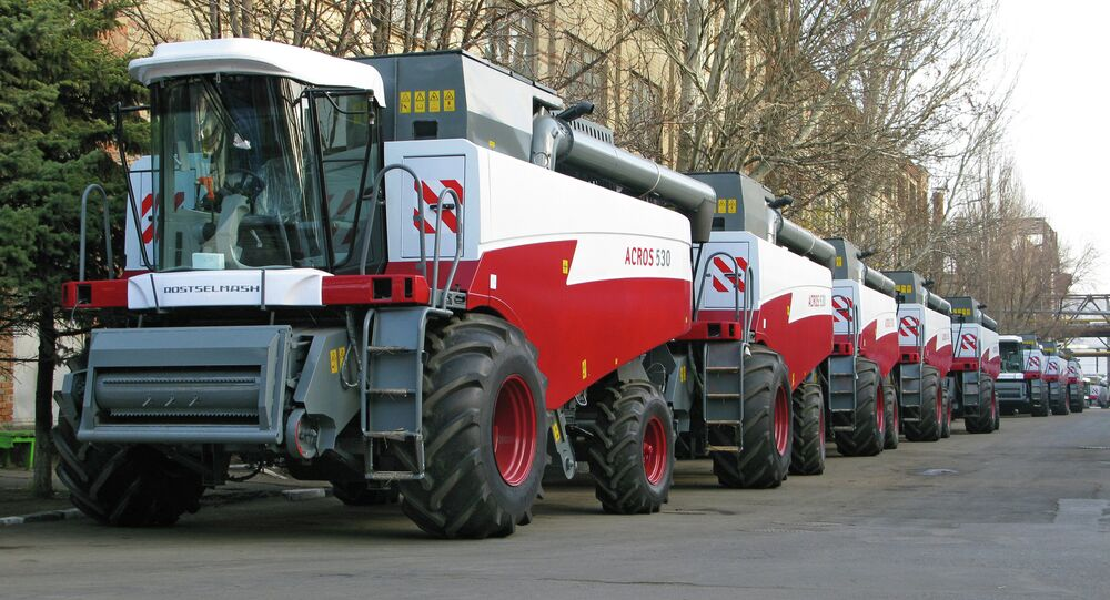 Rostselmash, among the world's largest agricultural equipment producers, has ambitious plans to increase its exports by 20 percent this year, noting that the devaluation of the ruble has increased the company's cost competitiveness. Pictured: ACROS-500 grain harvesters