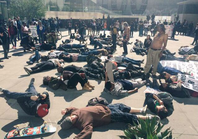 "Many demonstrated staged a 'die-in' in front of the building to show solidarity for ""Africa."""