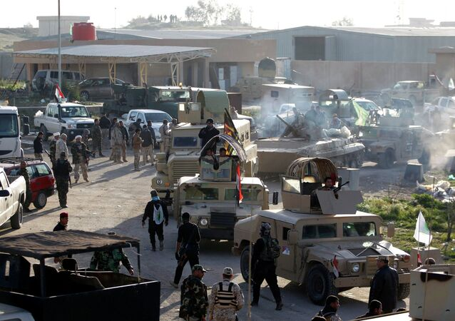 Iraqi security forces and Shi'ite Fighters are seen during clashes with Islamic State militants in Salahuddin province March 2, 2015