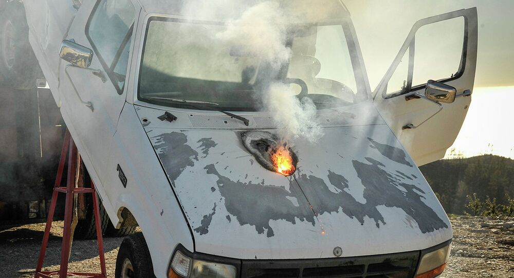 Lockheed Martin ATHENA laser weapon system defeats a truck target by disabling the engine, demonstrating its military effectiveness against enemy ground vehicles