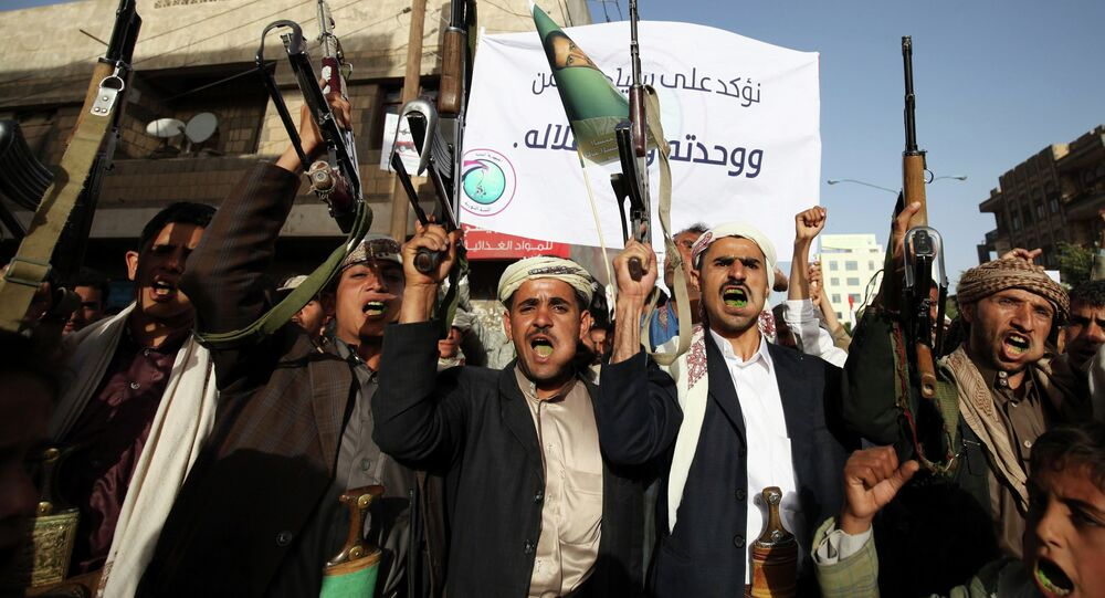 Followers of the Houthi movement shout slogans during a demonstration to show support to the movement, and rejecting foreign interferences in Yemen's internal affairs in Sanaa