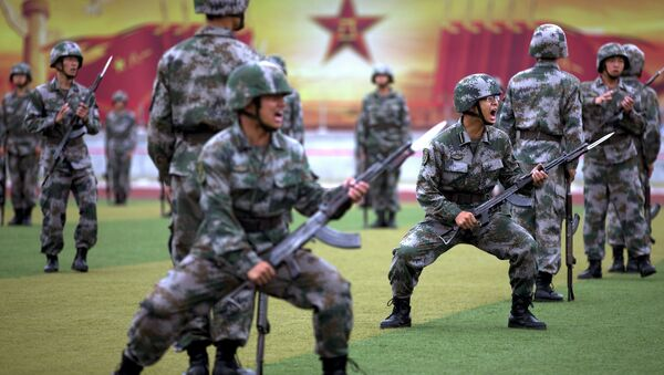 Chinese People's Liberation Army cadets shout as they take part in a bayonet drills at the PLA's Armoured Forces Engineering Academy Base, on the outskirt of Beijing, China - Sputnik International