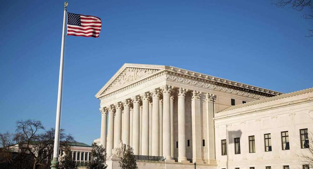The US flag flutters near the Supreme Court in Washington March 2, 2015. The Supreme Court will hear King v. Burwell