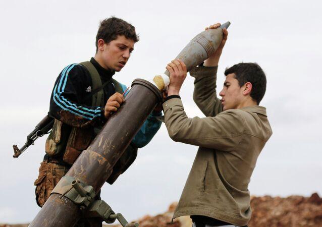 Al-Nusra Front members prepare to fire a mortar