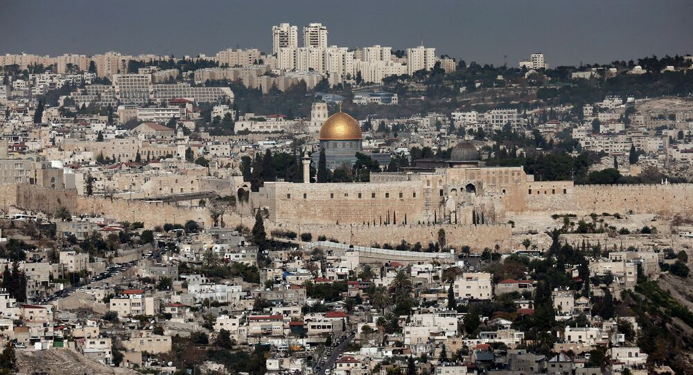 A general view shows the Dome of the Rock (C) and the Al-Aqsa mosques (R) in the Al-Aqsa mosque compound in Jerusalem's old city on November 21, 2014