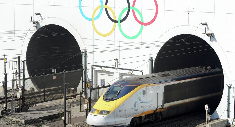 Olympic Rings marking the London 2012 Olympics Games are painted on the entrance to the Channel Tunnel as a Eurostar high-speed train travels through, before arriving at the Eurotunnel terminal in Coquelles, near Calais, northern France