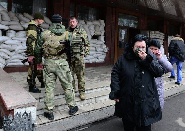 Relatives of miners leave the main entrance of the Zasyadko mine in Donetsk after the mine was rocked by an explosion on March 4, 2015