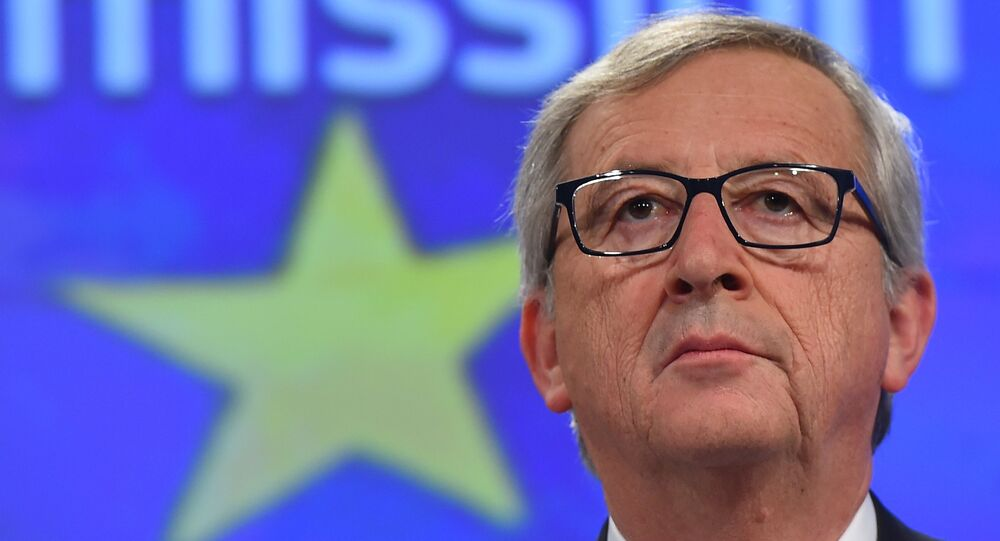 European Commission President Jean-Claude Juncker gives a press conference at the end of German chancellor's visit to the European Commission at the European Commission headquarters in Brussels, on March 4, 2015