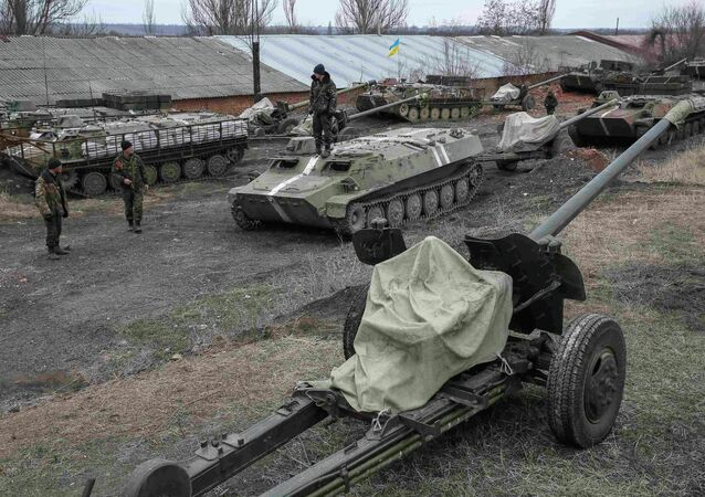 Ukrainian servicemen stand near armoured personnel carriers, military vehicles and cannons at their new position as they pull back from the Horlivka region, near Druzhkivka, eastern Ukraine, February 28, 2015