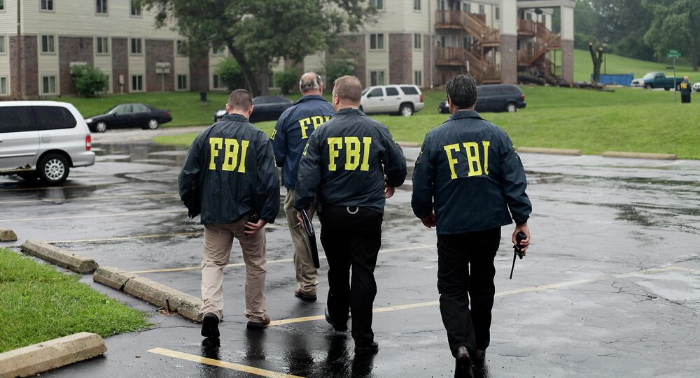 US Federal law prohibits retaliation against whistleblowers, but the FBI was exempted from the regulations and allowed to establish its own policy and procedures. Above: FBI agents.