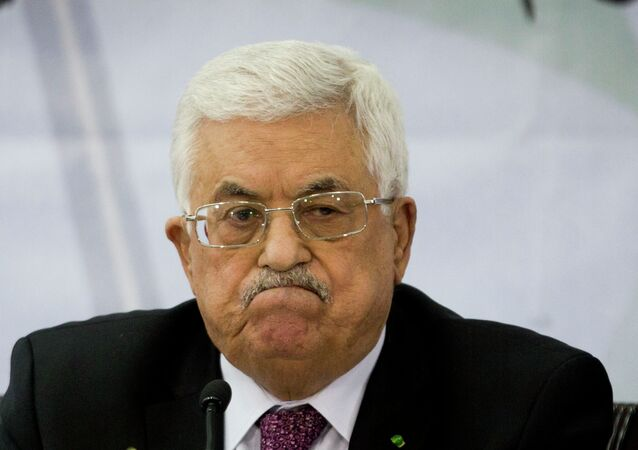 Palestinian President Mahmoud Abbas attends a meeting of the Central Committee of the Palestine Liberation Organization (PLO), in the West Bank city of Ramallah, Wednesday, March 4, 2015.