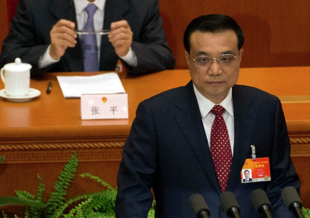 Chinese Premier Li Keqiang delivers the work report during the opening session of the National People's Congress at the Great Hall of the People in Beijing, Thursday, March 5, 2015