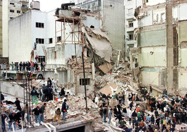 Rescue workers search for survivors and victims in the rubble after a powerful car bomb destroyed the Buenos Aires headquarters of the Argentine Israelite Mutual Association (AMIA), in this July 18, 1994 file photo