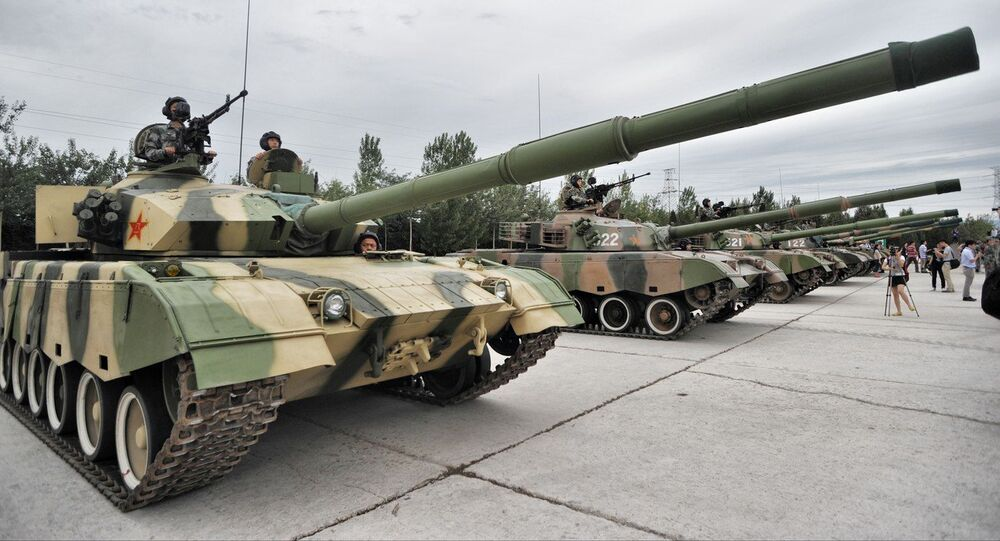 Chinese soldiers pose in tanks during a training session at the Academy of Armored Forces Engineering of the Peoples Liberation Army (PLA) in Beijing, China, 22 July 2014
