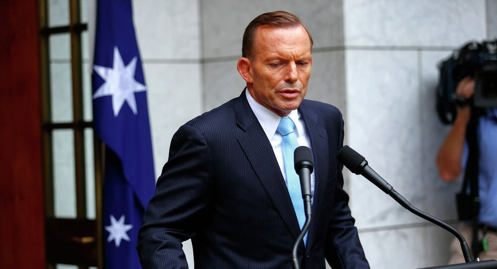 Australia's Prime Minister Tony Abbott addresses members of the media after a party room meeting at Parliament House in Canberra. File photo