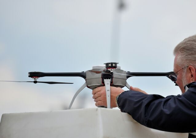 A technician prepares an unmanned surveillance drone at the Defence and Security Equipment International (DSEI) arms fair at the ExCeL centre in east London, on September 10, 2013