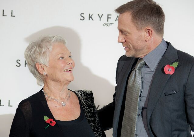 Actors Daniel Craig, right, and Dame Judi Dench pose for photographs at the photo call for the new James Bond film titled Skyfall.