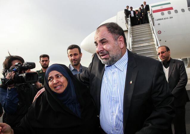 Iranian released diplomat Nour-Ahmad Nikbakht, who was kidnapped in Yemen and held hostage for nearly two years, hugs his wife upon his arrival in Tehran's Mehrabad airport on March 5, 2015