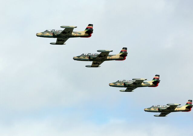 Libyan air force's advanced jet trainer and light ground-attack SOKO G-2 Galeb aircrafts take part in a ceremony marking the 50th anniversary of the Libyan navy's establishment in Tripoli on November 8, 2012