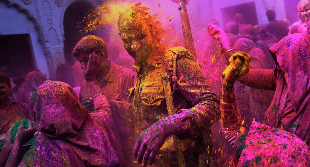 The police officer during celebration Holi  in Vrindavana, India (File)