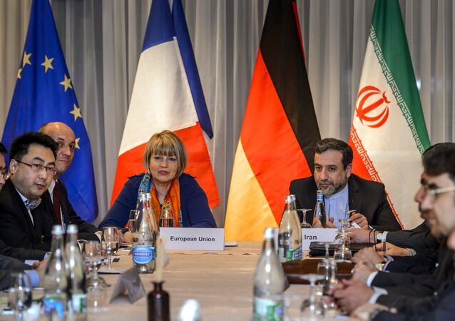 EU political director Helga Schmid (CL) seats next to Iran's deputy foreign minister Abbas Araqchi (R) at the opening of nuclear talks between Iran and Members of the P5+1 group on March 5, 2015 in Montreux