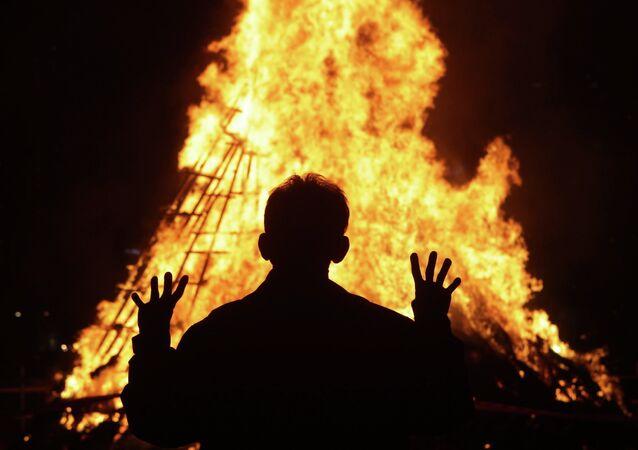 South Koreans gather around a bonfire during 'Jwibulnoli' a South Korean folk game on March 1, 2015 in Seoul, South Korea