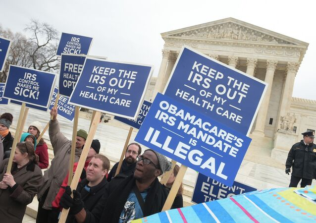Protestors hold placards challenging Obamacare outside of the US Supreme Court on March 4, 2015 in Washington, DC