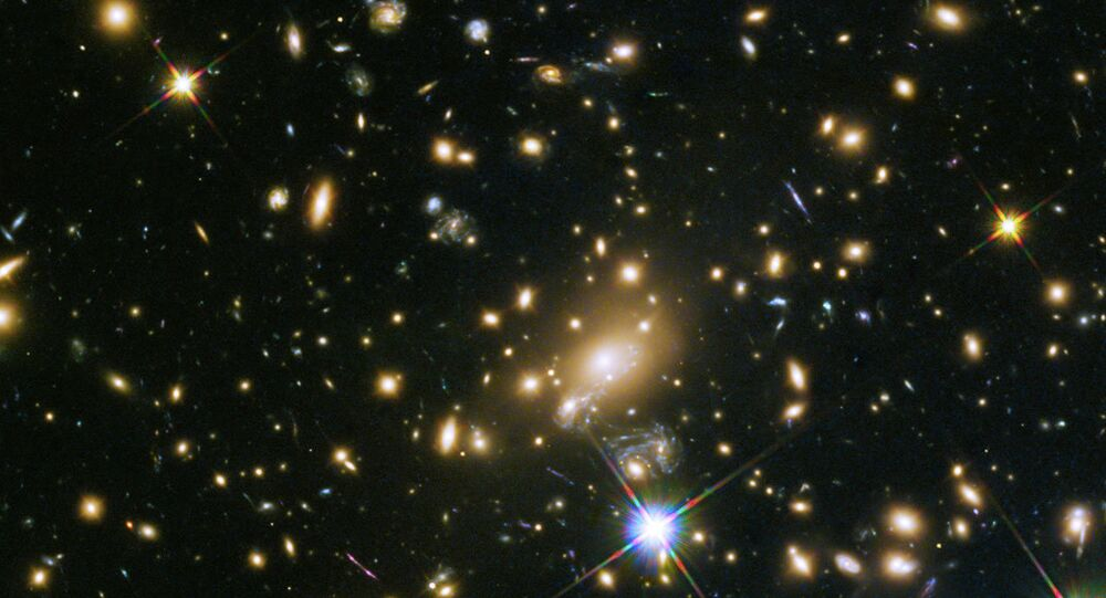 The galaxy cluster MACS J1149.5+223, whose light took over 5 billion years to reach us.