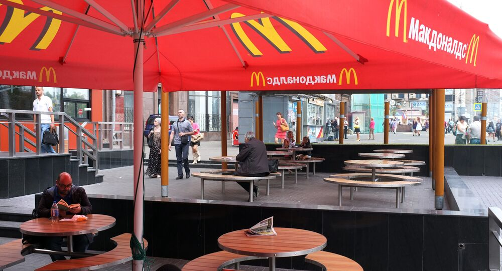 A senior Russian lawmaker has started a debate in the country's political circles by insisting that Russia should ban McDonald's and Coke in response to the extension of US sanctions.