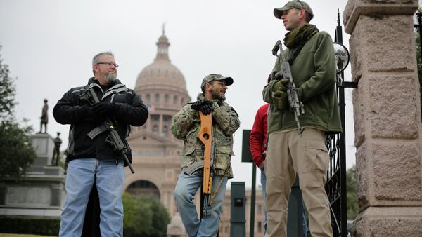 In this Jan. 13, 2015 file photo, gun rights advocates carry rifles while protesting outside the Texas Capitol in Austin, Texas - Sputnik International