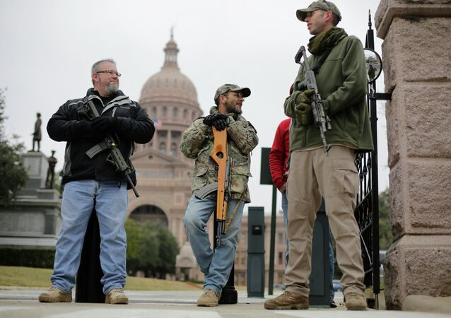 In this Jan. 13, 2015 file photo, gun rights advocates carry rifles while protesting outside the Texas Capitol in Austin, Texas
