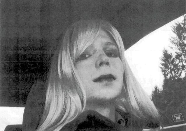 Pfc. Chelsea Manning poses for a photo wearing a wig and lipstick. Manning is suing the Defense Department for hormone therapy. Lawyers for the Army private formerly known as Bradley Manning and the American Civil Liberties Union filed the lawsuit Tuesday, Sept. 23, 2014, in Washington.