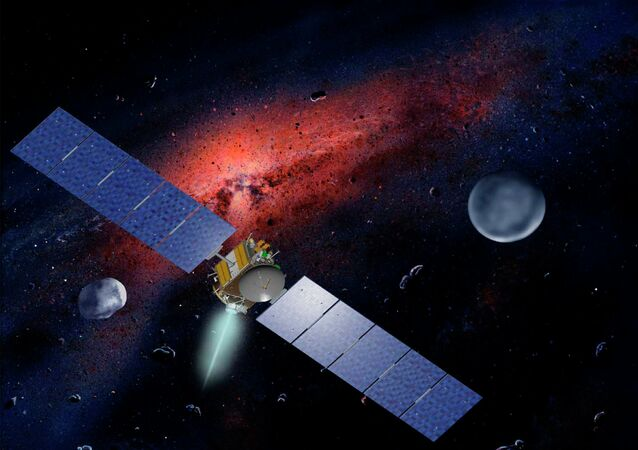 Artist concept released by NASA and the Jet Propulsion Laboratory shows the Dawn spacecraft with Ceres and Vesta seen in the background.