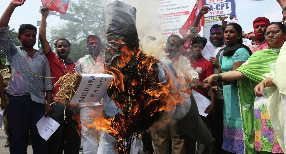 Activists of the Communists Party of India (CPI) burn an effigy representing the rapists convicted in the Dec. 16, 2012 gang rape in a moving bus in New Delhi, in Hyderabad, India