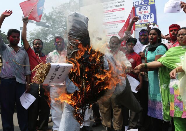 Activists of the Communists Party of India (CPI) burn an effigy representing the rapists convicted in the Dec. 16, 2012 gang rape in a moving bus in New Delhi, in Hyderabad, India.