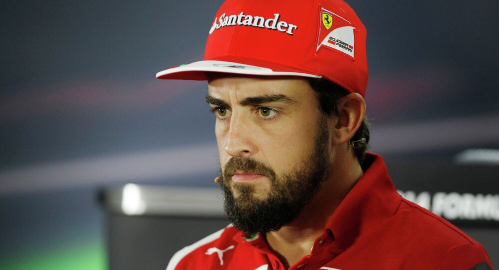 Ferrari driver Fernando Alonso of Spain answers to reporters during a news conference at the Yas Marina racetrack in Abu Dhabi, United Arab Emirates, Thursday, Nov. 20, 2014. Two-time Formula One champion Fernando Alonso is leaving Ferrari after the final race of the season and will be replaced by four-time champion Sebastian Vettel. The 33-year-old Spanish driver had said earlier this season that his future was elsewhere, likely at McLaren.