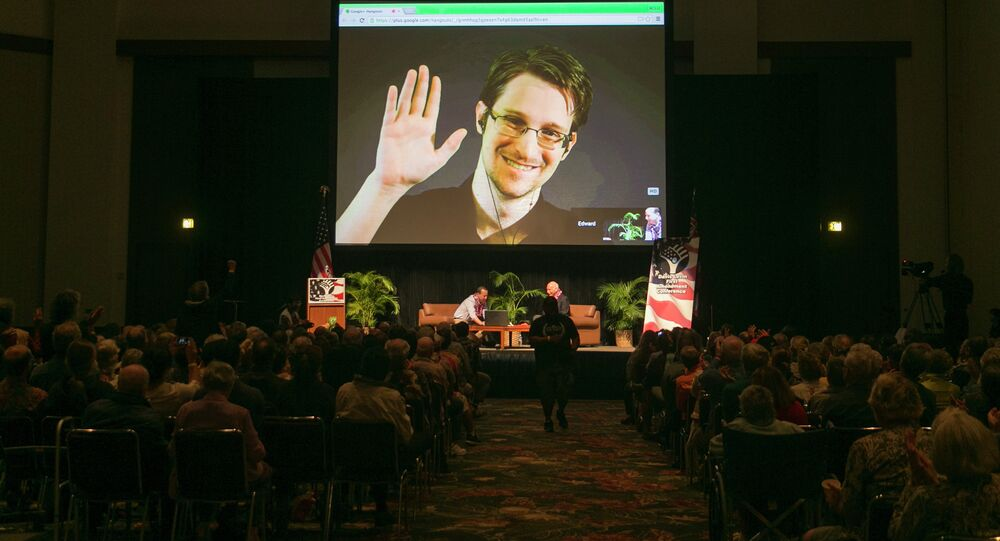 NSA leaker Edward Snowden appears on a live video feed broadcast from Moscow at an event sponsored by the ACLU Hawaii in Honolulu