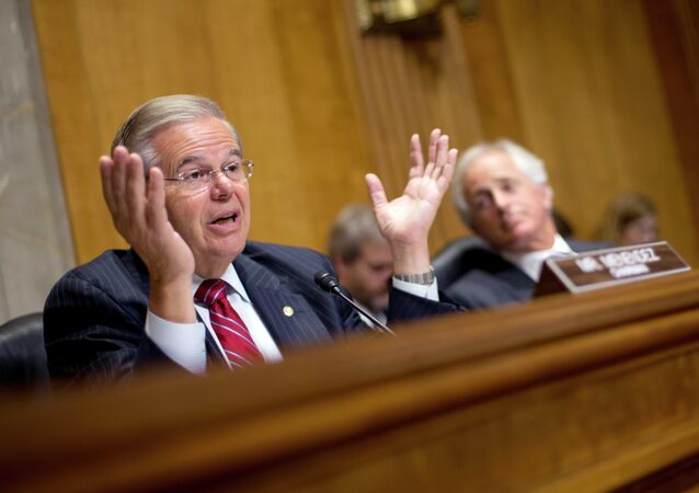 Chairman of the Senate Foreign Relations Committee, Sen. Robert Menendez, D-NJ., left, gestures as he speaks as ranking member Sen. Bob Corker, R-Tenn., sits right, during a hearing on Capitol Hill in Washington, Wednesday, July 9, 2014, to examine Russia and developments in Ukraine.