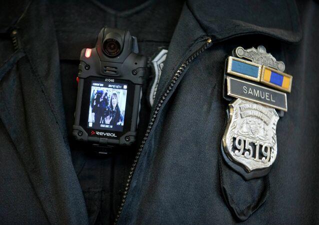 A Philadelphia Police officer demonstrates a body-worn camera