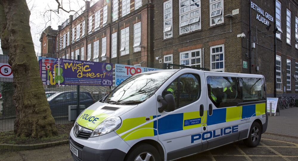 A police vehicle is pictured outside Bethnal Green Academy, where three missing British school girls attend, in east London, on February 23, 2015. Britain debated Sunday how to stop teenage girls joining the Islamic State group in Syria after three high-achieving youngsters